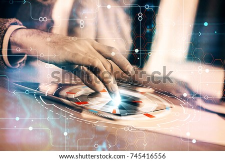 Businesspeople using tablet with abstract digital business interface. Teamwork and innovation concept. Double exposure  #745416556