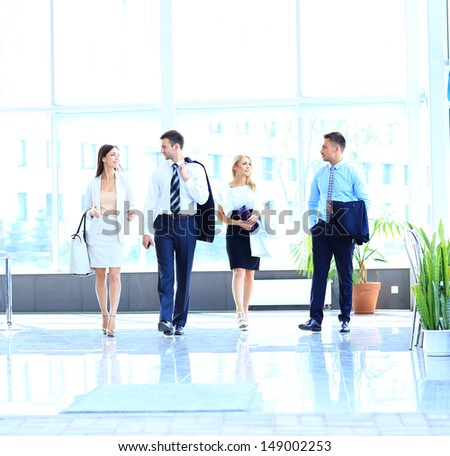 businesspeople walking in the corrido