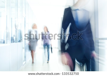 businesspeople walking in the...