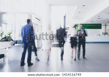 businesspeople walking in the corridor of an business center, pronounced motion blur #1414116749