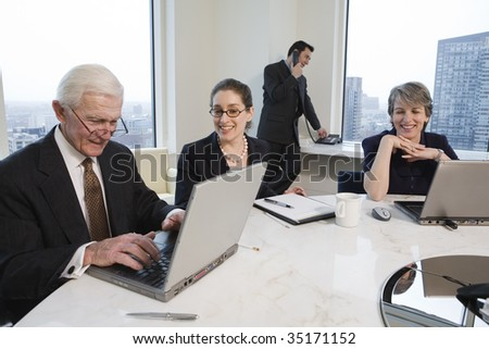 Businesspeople with laptops.