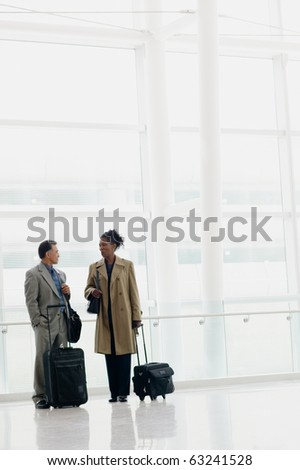 Businesspeople with luggage