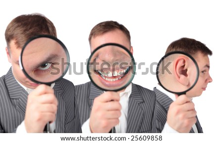 businesspeople with magnifier on ear, eye, mouth collage