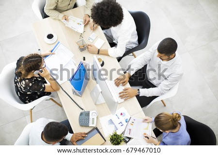 Businesspeople working in office - Shutterstock ID 679467010
