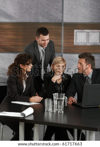 Businesspeople working together on meeting at office.?