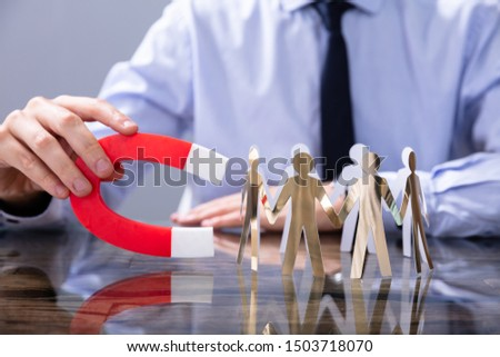 Businessperson Attracting Human Figures With Horseshoe Magnet #1503718070