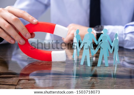 Businessperson Attracting Human Figures With Horseshoe Magnet #1503718073