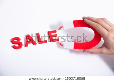 Businessperson Attracting More Sales With Horseshoe Magnet #1503718058