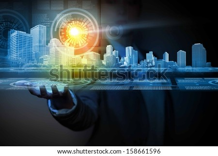 Businessperson holding media image of city in palm. New technologies #158661596