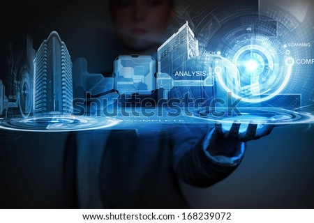 Businessperson holding media image of city in palm. New technologies