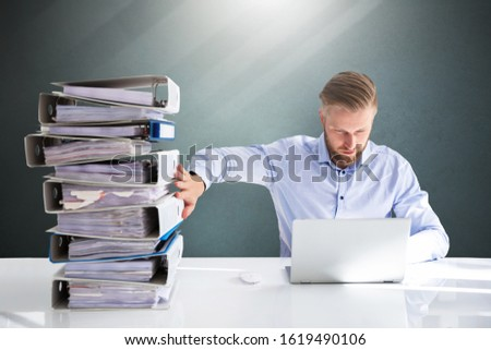 Businessperson Pushing Paper Documents Away And Working With Digital Documents On Computer Instead Stock photo ©