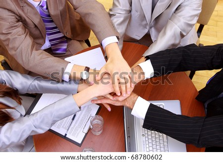 businessteam and hands on top of each other