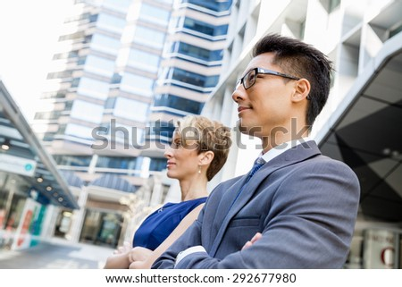 Businessteam members standing next to each other in business district #292677980