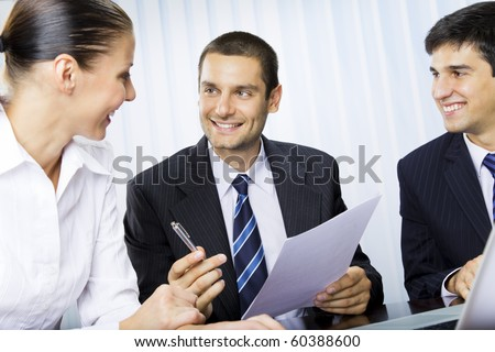 Businessteam or client and businessman, giving pen for signing document