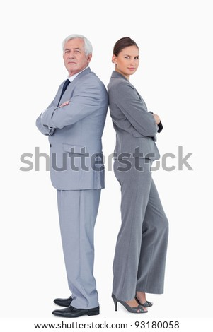 Businessteam standing back to back against a white background