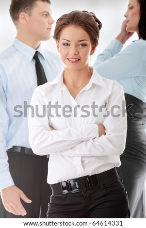 Businesswoman against two other businesspeople