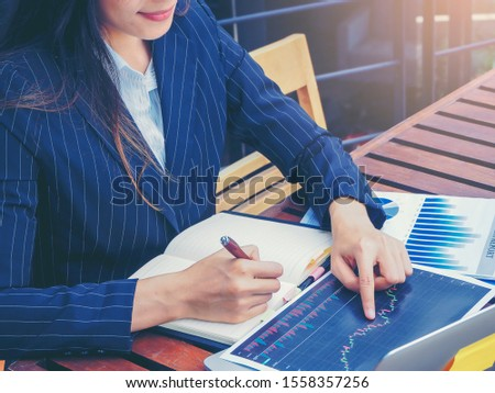 Businesswoman analyzing data together for planning to business investment in workplace