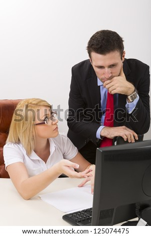 Businesswoman and businessman discussing about  difficult business issue at work. - stock photo