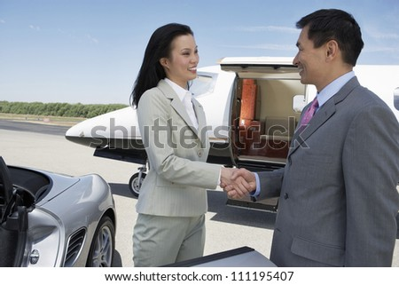 Businesswoman and businessman meeting at the airport