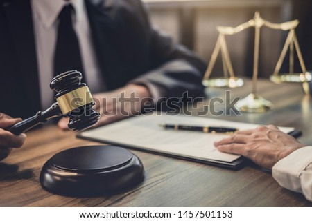 Businesswoman and Male lawyer or judge consult having team meeting with client, Law and Legal services concept.
