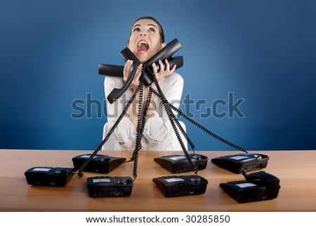 Businesswoman answering a lot of calls at the same time
