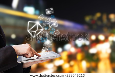 Businesswoman are sending email by using digital tablet