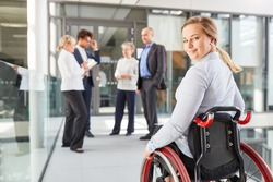 Businesswoman as a wheelchair user in business company for inclusion concept