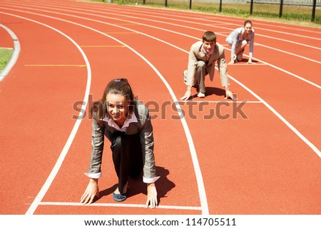 Businesswoman at athletic stadium and race track
