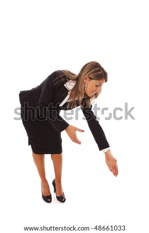 businesswoman bending over to help or grab something