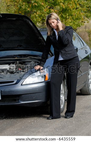 Businesswoman Beside Her Broken Down Car Making A Cellphone Mobile Call