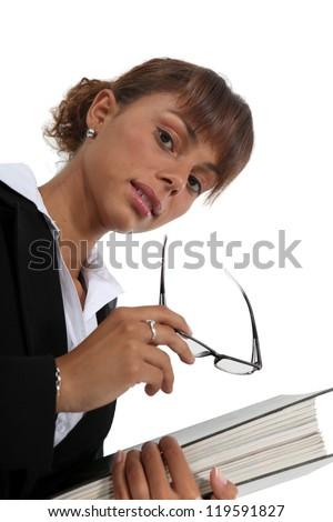 Businesswoman carrying a binder