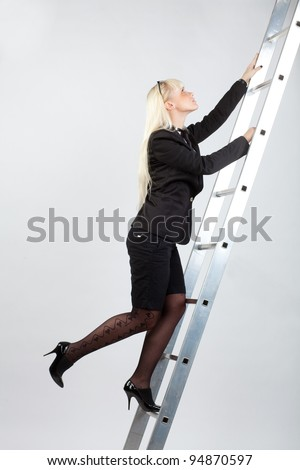 businesswoman climbing the stairs to the top