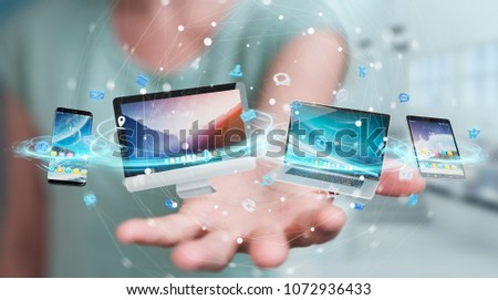 Businesswoman connecting tech devices and icons applications with each other 3D rendering