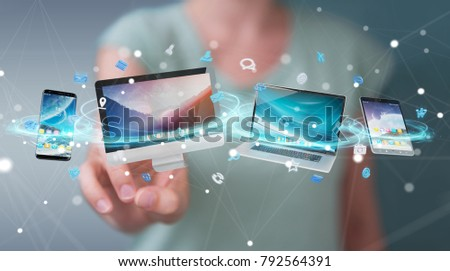 Businesswoman connecting tech devices and icons applications with each other 3D rendering #792564391