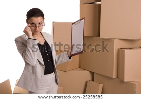 businesswoman correcting glasses keeping clipboard, on carton boxes background