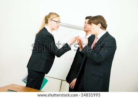 Businesswoman criticizing her colleague