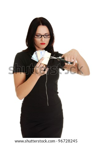 Businesswoman cutting credit cards with scissors
