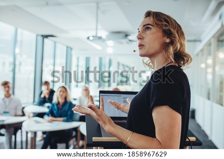 Businesswoman delivering a presentation at a conference. Female entrepreneur sharing new business ideas in a conference.