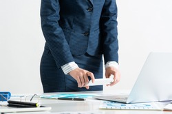 Businesswoman doing photo of paper document with smartphone. Online stock trading and investment. Manager in suit working with business analytics. Digital technology in business. Corporate espionage