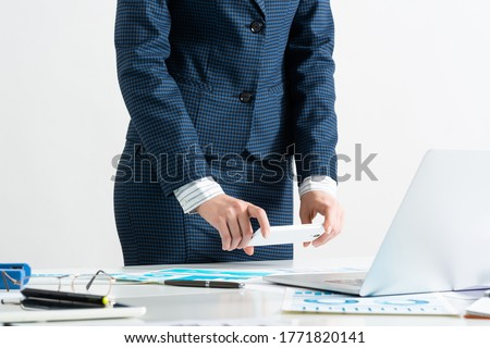 Businesswoman doing photo of paper document with smartphone. Online stock trading and investment. Manager in suit working with business analytics. Digital technology in business. Corporate espionage Foto stock ©