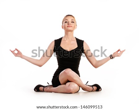 Businesswoman doing yoga on white background