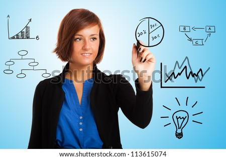 Businesswoman drawing business charts on the screen