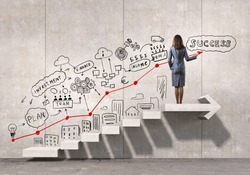 Businesswoman drawing strategy plan over ladder leading to success