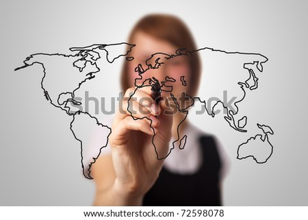 businesswoman drawing the world map in a whiteboard (on bokeh)
