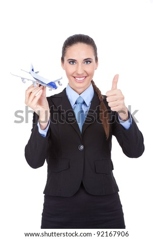 businesswoman employed in the airline agency with plan showing thumb up