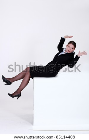 Businesswoman falling backwards