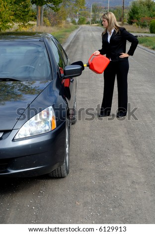 businesswoman filling her car up with gasoline after running out of gas by the side of the road. Black Bedroom Furniture Sets. Home Design Ideas