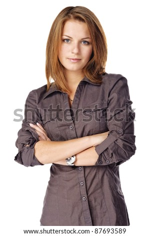 Businesswoman folding her arms. Isolated over white