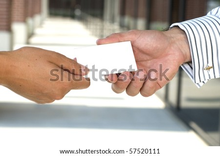 Businesswoman giving a business card to a man