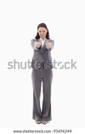 Businesswoman giving her agreement against white background